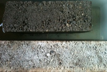 Comparing RADMYX untreated concrete (top) with a treated sample (bottom) in an immersion test